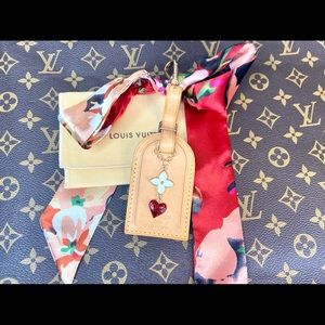 """Louis Vuitton large leather """"game on"""" looking tag"""